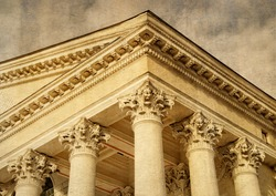 Ornate columns & a pediment in a style of classical architecture. Courthouse.  Classic style. Justice. Law. Legal system. Beautiful vintage photo on a paper background.