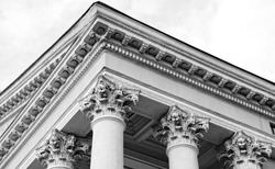 Ornate columns & a pediment in a style of classical architecture. Courthouse. Supreme court. Legal and order. Classic style. Justice. Law. Legal system. Court hearing. Lawsuit. Court proceeding