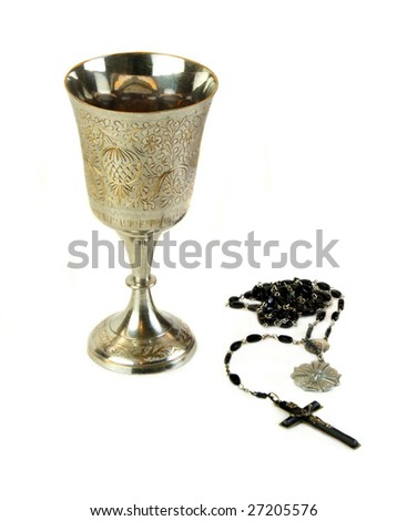 Ornate communion cup with a rosary isolated on white background.