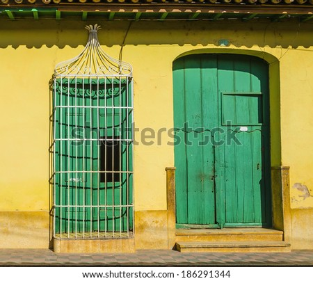 Ornate door in old town of Trinidad listed on UNESCO World Heritage List, colonial architecture, colonial buildings typical for Cuba.