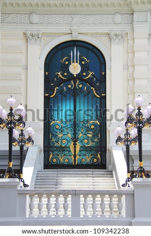 Ornate door of a mansion - stock photo