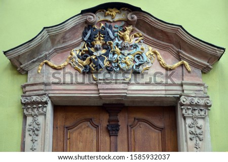 Ornate Entrance Doorway with Carved Stone Details in Color