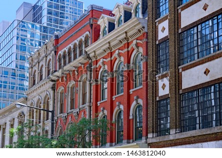 Ornate facades of preserved 19th century office buildings,  Toronto financial district, Wellington Street #1463812040