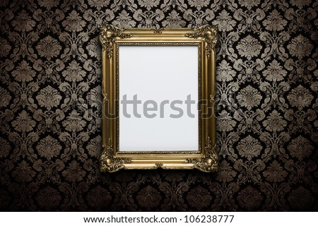 Ornate gold frame at grunge wallpaper with clipping path