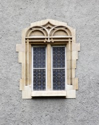 Ornate Gothic castle window in the wall.