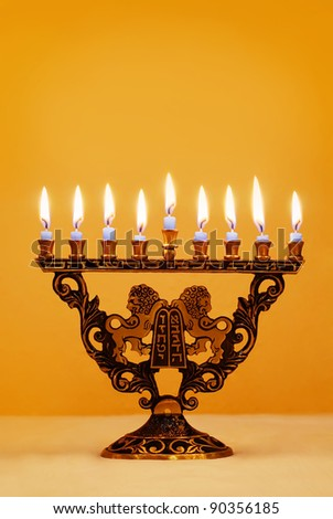 Ornate Hanukkah menorah with lions holding the Ten Commandments