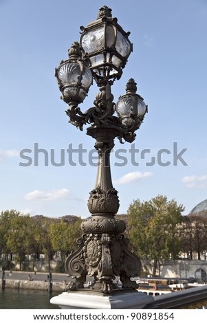 Ornate lamp post along the Pont Alexandre III in Paris