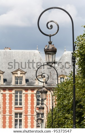 Ornate lampposts at Places du Vosages in Paris with shallow depth of field