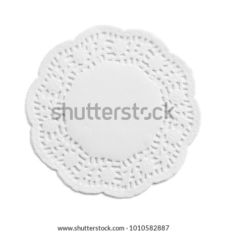 Ornate Paper Doily Isolated on a White Background. Сток-фото ©