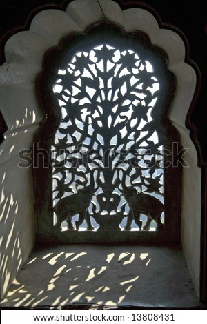 Ornate screen covering the window in the harem at Bundi Palace, Rajasthan