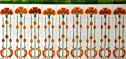 Ornate tiles decorated with tall red poppy like flowers. These are typical of the tiles found on the facade of traditional Chinese Peranakan shop houses.