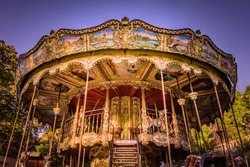 Ornate traditional carousel on a sunny morning in Montmartre, Paris, France