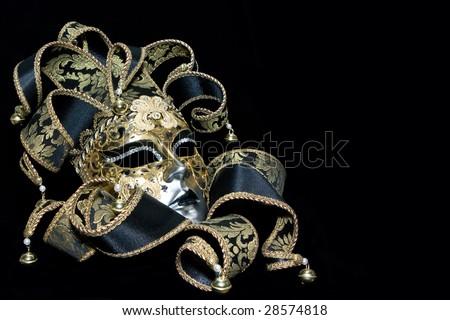 Ornate venetian mask lying on black background