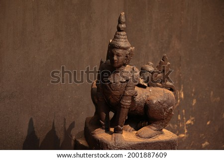 Ornate wooden sculpture display in the famous Baan Dam Museum or Black House in Chiang rai Thailand Stockfoto ©