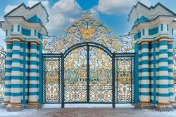 ornate wrought-iron gates to the Tsarskoye Selo palace in the city of Pushkin near St. Petersburg