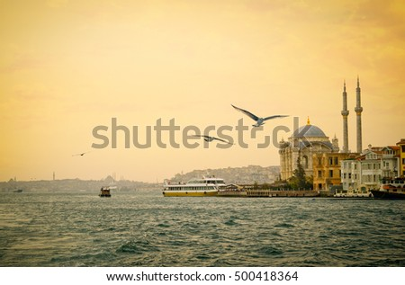 ortakoy mosque with flying...