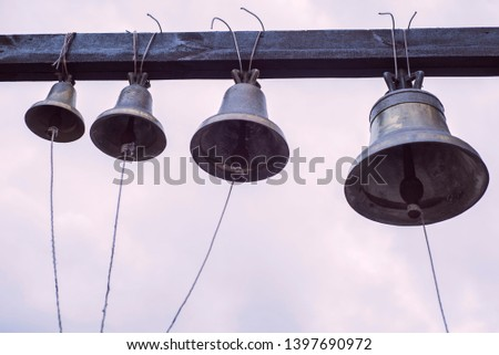 Orthodox bells closeup against the sky with clouds. New Jerusalem in town Istra, surroundings of Moscow, Russia.