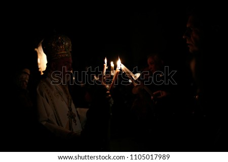 Orthodox Christian priest holds candles during an Easter vigil mass in the Cathedral of Archangels Michael and Gabriel in Brussels, Belgium on Apr. 8, 2018 #1105017989