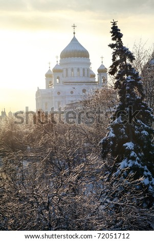 Orthodox church of Christ the Savior and trees after ice storm in Moscow, Russia