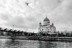 Orthodox Church of Christ the Saviour in Moscow Russia on a winter day under a cloudy sky with a view of the bridge. Black and white with 3D glitch virtual reality effect