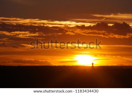 Orthodox church silhouette against sunset. Setting sun #1183434430