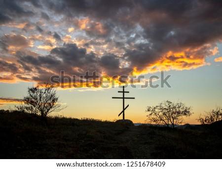 Orthodox cross against the sunset sky #1251678409