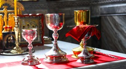 Orthodox faith. Gold and silver bowls for communion on the throne of the Orthodox Church. The concept of Orthodoxy.