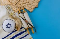 Orthodox Jewish prepared with kosher matzah on traditional pesach jewish passover holiday on torah scroll