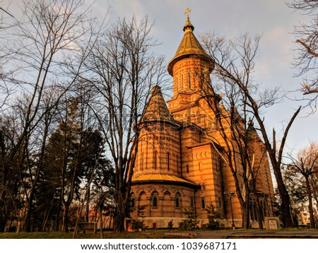 Orthodox Metropolitan Cathedral from the nearby park in Timisoara, Timis County, Romania. Lighted Orthodox Metropolitan Cathedral at dusk, Timisoara, Romania #1039687171