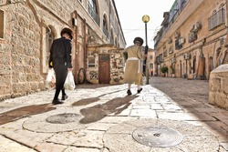 orthodox religious jews prepare for the holidays in their ultra hasidic neighborhood in jerusalem