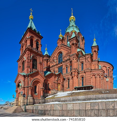 Orthodox Uspensky Cathedral in Helsinki, Finland, at sunny spring day. Panorama stitched from several shot. - stock photo