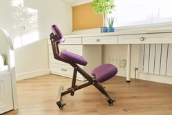 Orthopedic ergonomic kneeling chair in the interior of children's room, home office. Taking care of your back health, healthy lifestyle