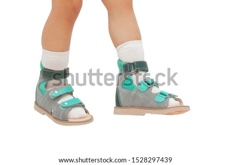 Orthopedic shoes on the feet of a child isolated on white background #1528297439