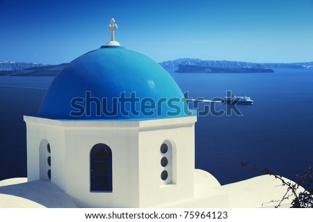 Ortodox church and ferry at Oia (Ia) village on Santorini island.