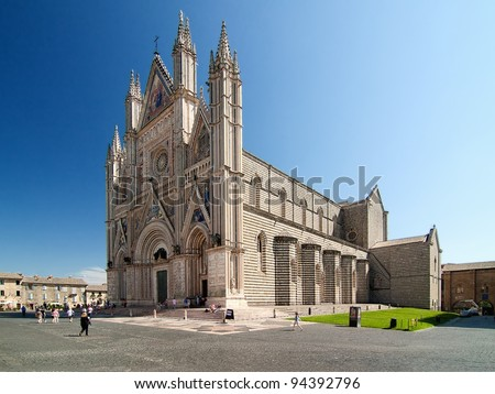 Orvieto Cathedral, Umbria, Italy. Orvieto is noted for its Gothic cathedral, or duomo. The church is striped in white travertine and greenish-black basalt in narrow bands.