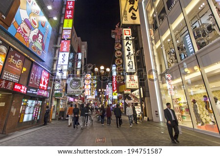 OSAKA - APRIL 16: Japanese Billboard sign in Osaka, Japan on April 16, 2014. Famous for big illuminated creative billboards along Dotonbori where tourist can spend colorful night life.