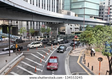 OSAKA, JAPAN - APRIL 25: Cars drive in heavy traffic on April 25, 2012 in Osaka, Japan. According to Tripadvisor, it is currently among best 3 shopping places in Osaka.