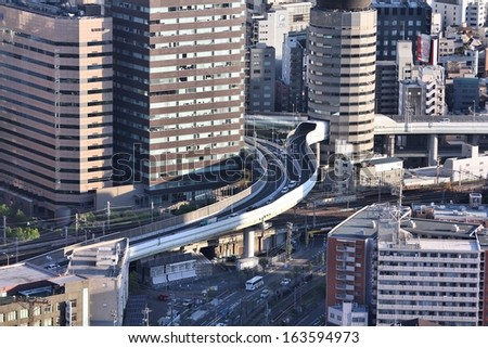 OSAKA, JAPAN - APRIL 27: Cars ride through Gate Tower Building on April 27, 2012 in Osaka, Japan. The building is extremely popular because of highway crossing through it.