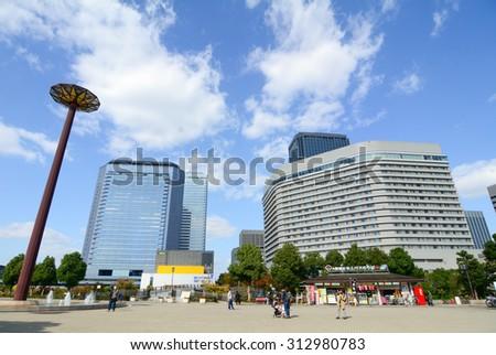 OSAKA JAPAN - APRIL 24, 2015. Modern buildings in Osaka, Japan. Osaka is the third largest city and an economic hub of Kansai region.
