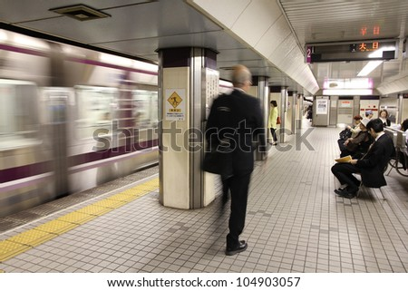 OSAKA, JAPAN - APRIL 27: People wait at Osaka Subway station on April 27, 2012 in Osaka, Japan. Osaka Subway is 12th busiest metro system worldwide with 837 million annual ridership (2010).