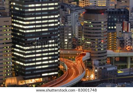 OSAKA, JAPAN - JULY 13 : With a Metropolitan area of nearly 18 million people, Osaka is Japan's second largest city July 13, 2011 in Osaka, Japan. - stock photo