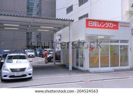 OSAKA JAPAN - 3 JUNE, 2014: Nissan Car rental. Nissan Car rental is one of the major car rental companies in Japan.