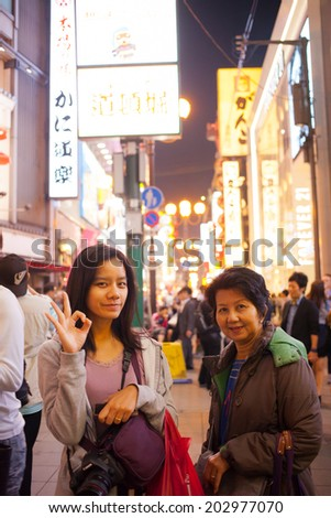OSAKA, JAPAN - MAY 15 Tourist with smiling pose in night market on May 15, 2013 in Namba, OSAKA, Japan. Night market in Namba is a famous area in Osaka.
