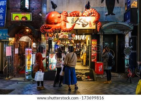 OSAKA, JAPAN - NOVEMBER 17: Japanese Billboard sign in Osaka, Japan on November 17, 2013. Famous for illuminated creative billboards along Dotonbori street where tourist can spend colorful night life