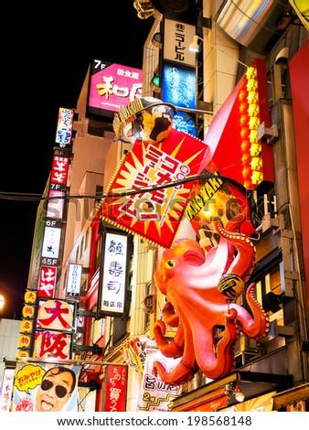 OSAKA, JAPAN - NOVEMBER 30: Japanese Billboard sign in Osaka, Japan on November 30, 2012. Famous for illuminated creative billboards along Dotonbori street where tourist can spend colorful night life