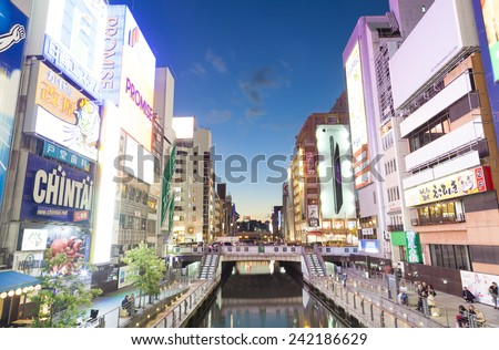 Osaka, Japan - Oct 28: Tourists visiting Dotonbori Canal in Osaka, Japan at night on Oct 28, 2014.  Dotonbori is one of the principal tourist destinations in Osaka, Japan.