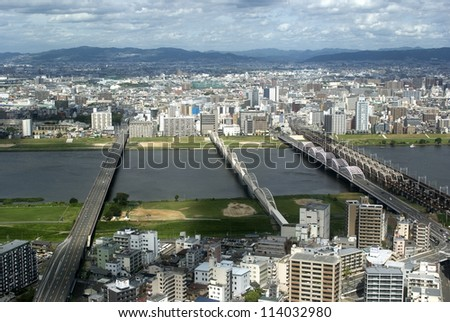 OSAKA, JAPAN - SEPTEMBER 17 : Aerial view of the city 17 September 2012. Osaka Japan. Osaka is the second biggest town in Japan and the finacial and business district of the Kansai region.