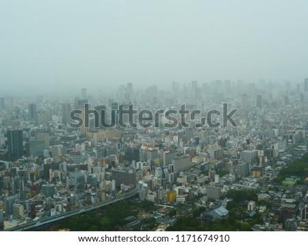 Osaka, Japan-September4,2018; taifun Jebi attacks downtown osaka from high building #1171674910