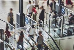 Osaka station escalators and people