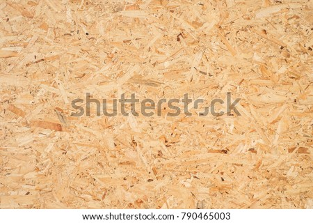 OSB boards are made of brown wood chips sanded into a wooden background. Top view of OSB wood veneer background, tight, seamless surfaces. Foto d'archivio ©